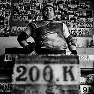 "Juan Jose Unanua ""Goenatxo"", stone lifter or harrijasotzaile in Basque language. Concentrates before he lifts a 200 k stone while training at home in Azkoitia. Basque rural sports (Herri Kirolak in basque language) are rooted in traditional lifestyles, mostly farmer occupations of the Basque Country, in Northern Spain. Nowadays they have transform themselves into sports based in strenght and skill. Stone lifting and wood chopping are the most popular."