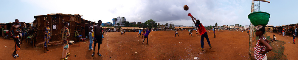 The girls football team of Save the Children Kroo Bay children's club train ahead of the inter slum competition, Kroo Bay, Freetown, Sierra Leone.