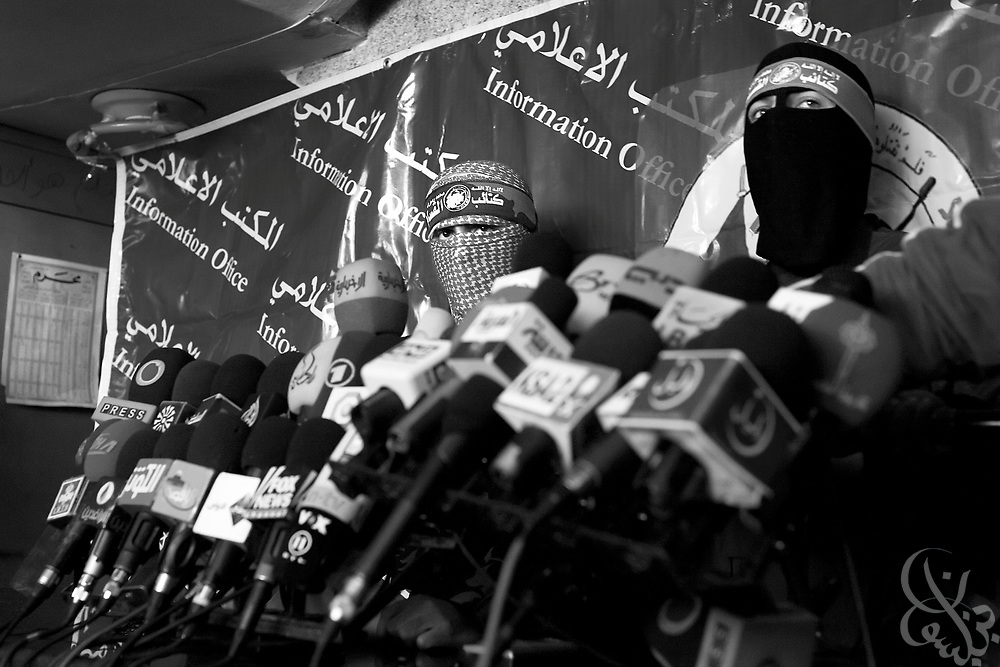 Spokesmen for the al-Qassam Brigade, the military wing of the Islamic HAMAS Movement appear at a press conference January 19, 2009 in Gaza City. The group defiantly claimed it would continue to find ways to smuggle in weapons despite a recent agreement between the United States and Israel to step up efforts to stop illegal arms smuggling through tunnels along the Egyptian border.