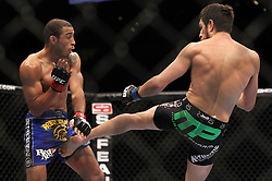 October 8, 2011; Houston, TX.; USA;  UFC Featherweight Champion Jose Aldo (blue trunks) and challenger Kenny Florian (black trunks) during their fight at UFC 136 at the Toyota Center in Houston, TX.