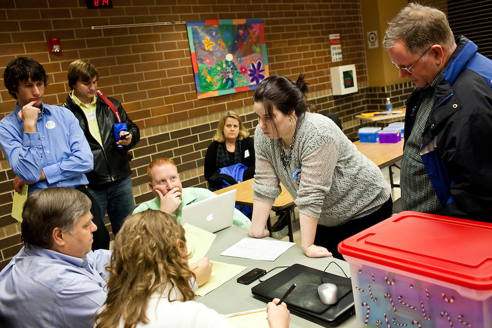 Votes are counted at a caucus site at Summit Middle School on Tuesday, January 3, 2012 in Johnston, IA.