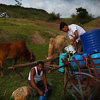 Farmers from Aurangabad, India make one last effort to save a failing cotton crop, India has seen one of the worst droughts in 25 yr. Climate change has altered the moonsoon season in India, these kind of rainfall failures have a lot of real human effects, large groups of people lose their lively hood and there becomes acute drinking water problems since rains are needed to recharge ground water.