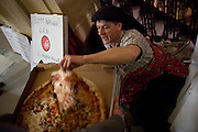 A protestor takes a slice from an Ian's Pizza donated to protestors at the State Capitol in Madison, WI, February 23, 2011.