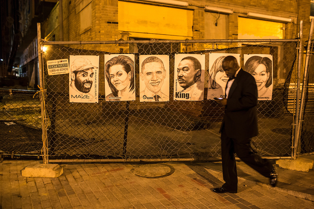 A man walks past posters of President Obama and other prominent African-Americans outside The Dream: Moving Forward Inaugural Gala at the Howard Theater on Sunday, January 20, 2013 in Washington, DC.
