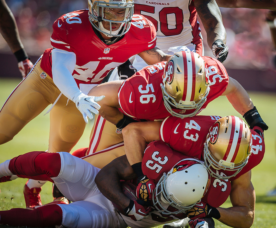 SAN FRANCISCO, CA - October 13  Darryl Morris #40, Craig Dahl #43 and Nathan Stupar #56 of the San Francisco 49ers make a tackle during the game against the Arizona Cardinals at Candlestick Park on October 13, 2013 in San Francisco, California. The 49ers defeated the Cardinal 32-20. (Photo by Jean Fruth/San Francisco 49ers