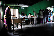 A woman casts her vote at a polling station during the second phase of voting in parliamentary elections April 23, 2009 in the Muslim dominated town of Mukalmua in the state of Assam, India. Polling took place amid tight security after several acts of militant violence in recent days.