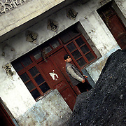 Coal is everywhere, even at the footsteps of homes.  A home in the village of Wangjiazhai.