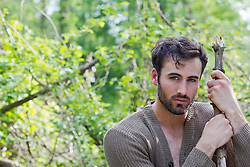 handsome man with a beard outdoors in the woods