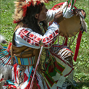 Portrait Carlos Eagle Feather, Mayan and Apache, Native American, dressed in Pow Wow Regalia.  <br /> <br /> Carlos in is a Thunderbird pow wow dancer at the Drums along the Hudson Pow Wow.<br /> Examples of ethnic pride, heritage, celebration, and traditional folk art crafts.