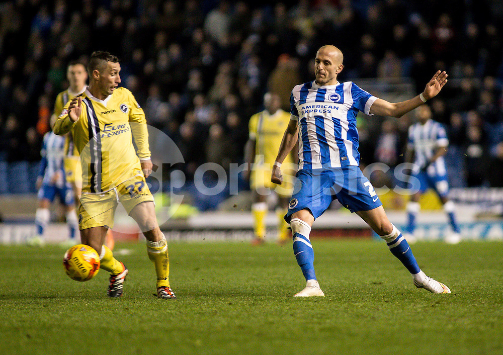 Bruno Saltor of Brighton and Scott McDonald of Millwall during the Sky Bet Championship match between Brighton and Hove Albion and Millwall at the AMEX Stadium, Brighton, England on 12 December 2014. Photo by Liam McAvoy.