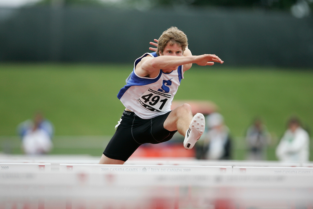 (Charlottetown, Prince Edward Island -- 20090717) Derek Drouin of Sarnia Athletics Southwes competes in the sprint hurdles at the 2009 Canadian Junior Track & Field Championships at UPEI Alumni Canada Games Place on the campus of the University of Prince Edward Island, July 17-19, 2009.  Copyright Geoff Robins / Mundo Sport Images , 2009...Mundo Sport Images has been contracted by Athletics Canada to provide images to the media.