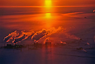 Frigid air boils with scorching exhaust from a North Slope oil processing plant.  If oil is discovered in the Arctic Refuge, development would cover less than one percent of its 19 million acres