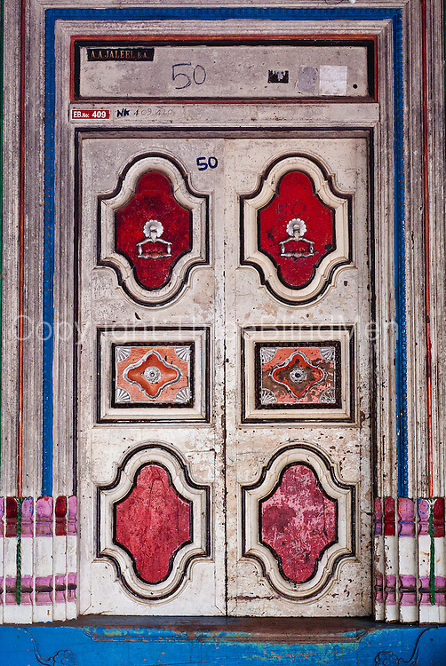 Painted door. Home in Nagore. East Coast.