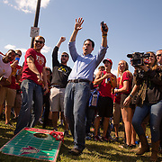 AMES, IA - SEPTEMBER 12: Republican presidential candidate Gov. Scott Walker (R-WI) celebrates a shot while tossing some bags with tailgaters Saturday, Sept. 12, 2015, before the Iowa State University football game against University of Iowa outside Jack Trice Stadium in Ames, Iowa. Scott Morgan for The New York Times