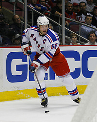 Feb 20, 2007; East Rutherford, NJ, USA; New York Rangers forward Jaromir Jagr (68) is hounded by New Jersey Devils forward Jay Pandalfo (20) during the second period at Continental Airlines Arena in East Rutherford, NJ.