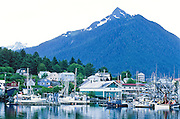Alaska. Sitka. View of Sitka from across Sitka Channel with fishing boats.