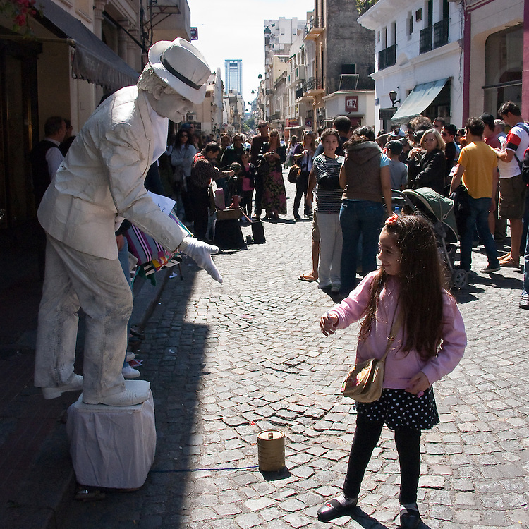 It looks like the sculpture is alive after all. Sunday market in Buenos Aires, Argentina.
