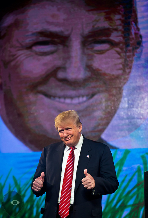Republican Presidential candidate Donald Trump is pleased by the crowd's support as he speaks at the 2015 FreedomFest in Las Vegas, Nevada July 11, 2015.