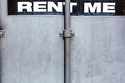 rent me sign on a metal door