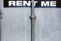 rent me sign on a metal door