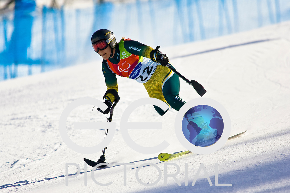 SESTRIERE COLLE, ITALY - MARCH  16th : Emily Jansen (LW2) of Australia on her first run of the Womens Alpine Skiing Giant Slalom Standing competition on Day 6 of the 2006 Turin Winter Paralympic Games on March 16th, 2006 in Sestriere Borgata, Italy.