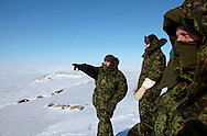 Lieutenant Colonel Glen McNeil (L) from Joint Task Force North, commanding  operation Nunalivut 2012, watch from atop Beechy Island the vast arctic landscape that Canada is committed to guard. April 2012.