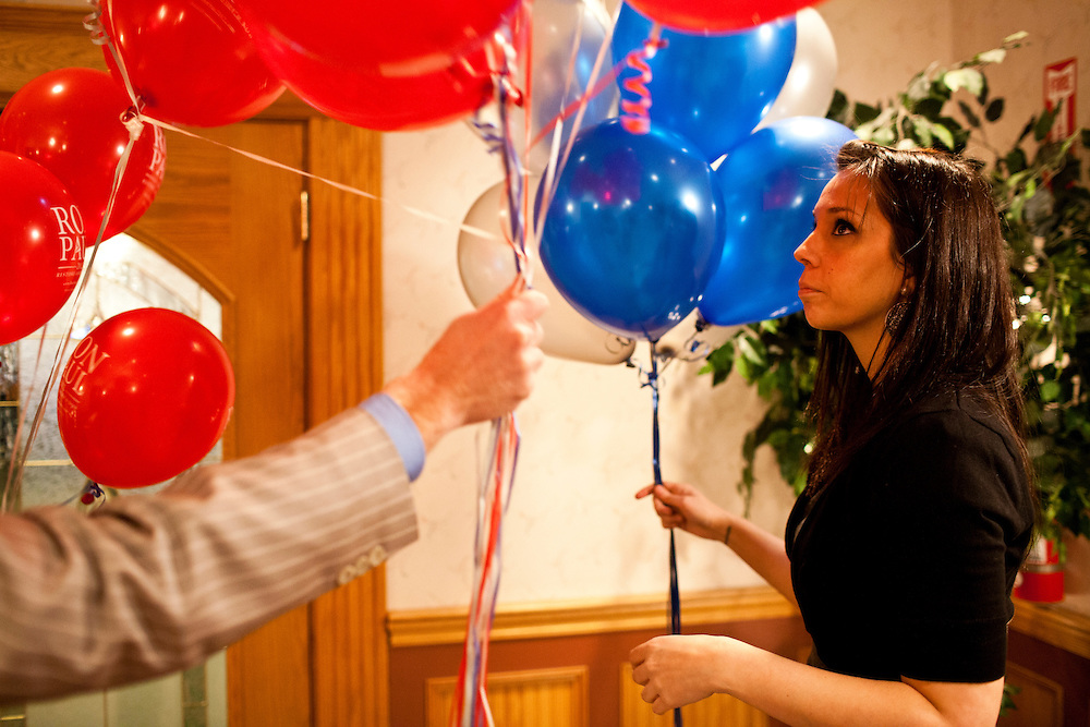 Allison Gibbs, an advance staffer for the campaign of Republican presidential candidate Ron Paul, preps balloons for a primary night rally at the Executive Court banquet facility on Tuesday, January 10, 2012 in Manchester, NH. Brendan Hoffman for the New York Times