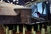 Welding works, connecting the parts that will make a ship