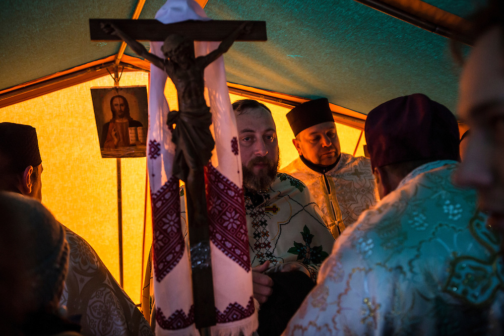 A Ukrainian Orthodox priest leads a service for anti-government protesters inside a tent on Independence Square. The Ukrainian Orthodox Church has aligned itself with the protesters.
