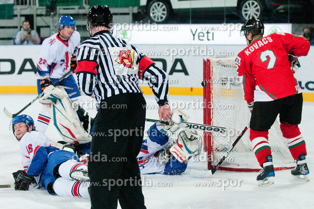 Puck hits the goal post during ice-hockey match between Hungary and Great Britain at IIHF World Championship DIV. I Group A Slovenia 2012, on April 21, 2012 at SRC Stozice, Ljubljana, Slovenia. (Photo By Matic Klansek Velej / Sportida.com)