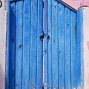 Oia, Santorini Island, Greece: blue painted wood gate