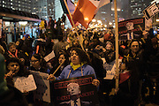 """""""Racist, sexist, anti-gay! Donald Trump, go away!"""" a crowd chants outside of Trump Tower in downtown Chicago on Inauguration Day, January 20, 2017."""