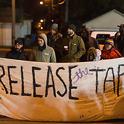 Protesters with the Black Lives Matter movement gather for a night of community and protest outside the Minneapolis Police Department 4th precinct headquarters on Thursday, November 19, 2015 in Minneapolis, Minnesota. <br /> <br /> Protests and an encampment at the site have been ongoing since the police shooting of 24-year-old Jamar Clark by Minneapolis Police on Sunday, November 15. An ongoing demand of protesters is that authorities release the tapes that exist of the shooting incident. <br /> <br /> A more mellow and festive atmosphere, with a smaller police presence, prevailed after Wednesday evening's tear gas clashes between police and protesters. <br /> <br /> <br /> Photo by Angela Jimenez for Minnesota Public Radio www.angelajimenezphotography.com