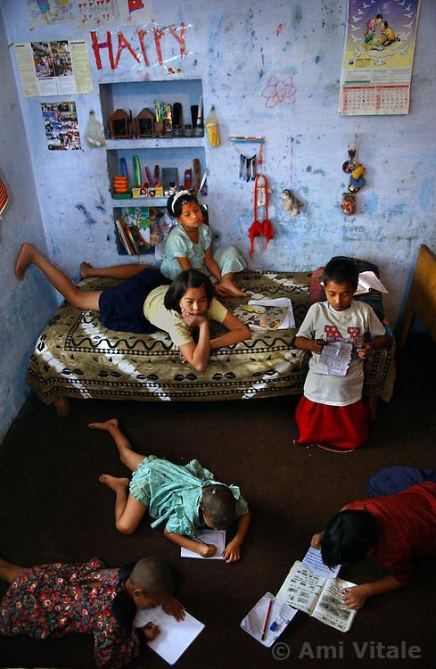 NEPALGANJ, NEPAL, APRIL 14, 2004:  Nepali girls who were orphaned because of the Maoist insurgency study inside the Sahara orphanage in Nepalganj, Nepal April 14, 2004.   (Ami Vitale/Getty Images)