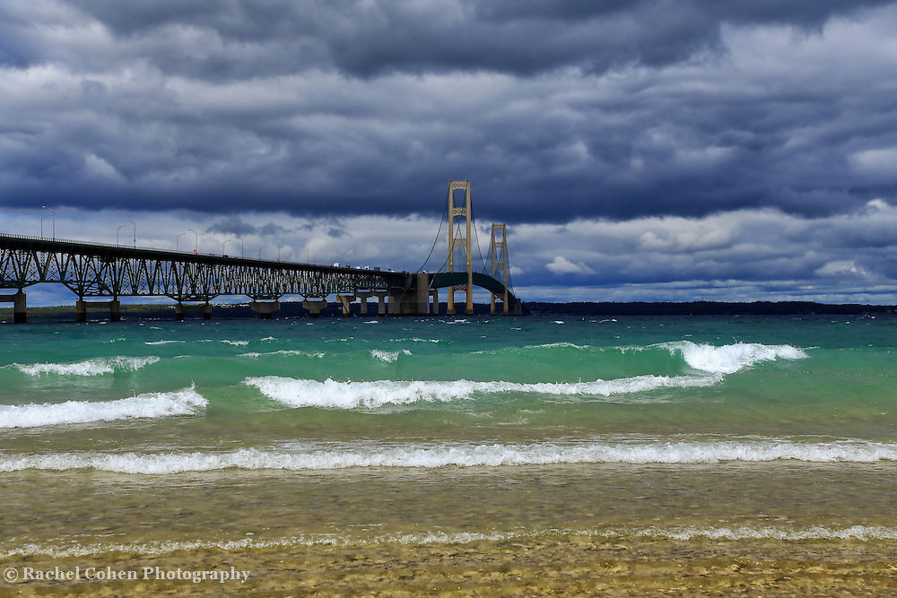 &quot;Rolling with the Mack&quot;<br /> <br /> The beautiful Mackinac Bridge crossing over the straits of Mackinac. Layers of clouds, and colors of water in all hues of blue!!<br /> <br /> Mackinac Bridge by Rachel Cohen