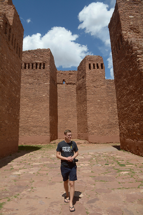 gbs041217i/STATE -- Mikah Meyer of Lincoln, Nebraska, walks through ruins of the Quarai mission church on Wednesday, April 12, 2017. He is on a quest to visit all of the 415+ U.S. National Park Service sited in one continuous journey. (Greg Sorber/Albuquerque Journal)