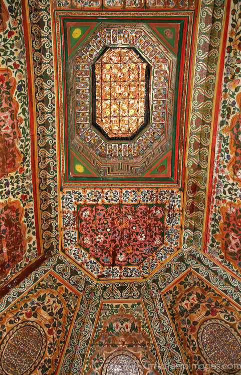 North Africa, Morocco, Marrakesh. Painted zellij woodwork ceiling at El Bahia Palace