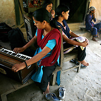 Members of a performance group of the People?s Liberation Army, the Maoist rebels that have been fighting for control of the country, rehearse in a remote part of western Nepal on June 20, 2006. The ten-year old conflict in Nepal has claimed an estimated 13,000 lives. (Photo/Scott Dalton)