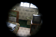 The view of a typical room/cell inhabited by one elderly prisoner, complete with tatami mat flooring, a television, a futon to sleep on, a sink and a toilet, in Onomichi prison , Japan. May 19th 2008