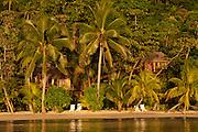 Beach and guest lodging at Matangi Private Island Resort, Fiji.