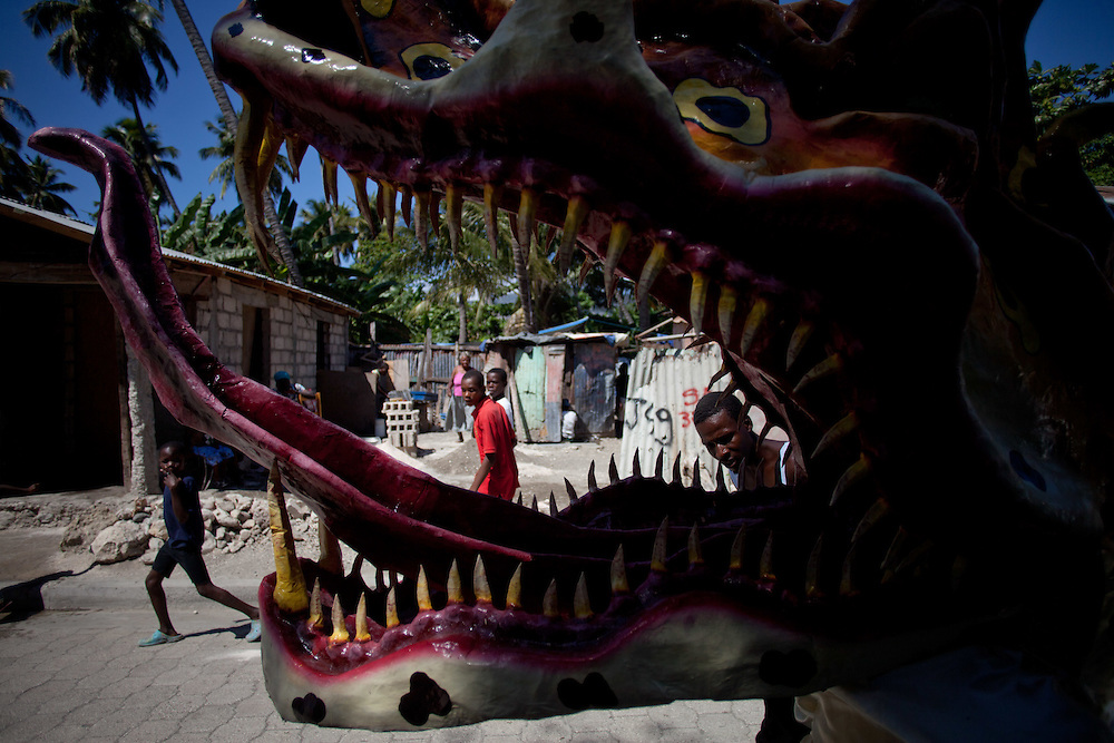 The carnival celebrations in Jacmel are famous for intricate paper mache masks and street theater. Carnival celebrations did not happen last year in Haiti becuase of the January 12th earthquake. For many of the artisans in Jacmel the revenue from carnival is their primary source of income./// A paper mache dragon on the street before the big carnival parade.