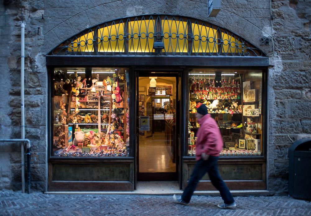 Bergamo, Italy - A man enters in a toy store in Via Gombino, the main street of the historical centre of Città Alta, Upper Bergamo
