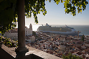 Seen from Miradouro de de Santa Luzia, the 'Independence of the Seas' cruise liner dominates the medieval/Moorish district rooftops of Alfama, on 13th July 2016, in Lisbon, Portugal. Pollution from such huge ships is a toxic problem that is growing as the cruise industry and its ships get ever bigger, docking close to communities with narrow streets such as Lisbon. MS Independence of the Seas is a Freedom-class cruise ship operated by the Royal Caribbean cruise line which entered service in April 2008. The 15-deck ship can accommodate 4,370 passengers and is served by 1,360 crew. (Photo by Richard Baker / In Pictures via Getty Images)