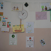 Children's drawings on a wall in the kitchen of Villa Artemis, a shelter for 30 refugee women and their children in the grounds of Leros Hospital. <br /> <br /> Opened in September 2015, the shelter was run by the Leros Solidarity Network. However, Villa Artemis was closed down shortly after the opening of a 'Hotspot' (EU-run migrant's reception centres) camp in Lepida in February 2016.
