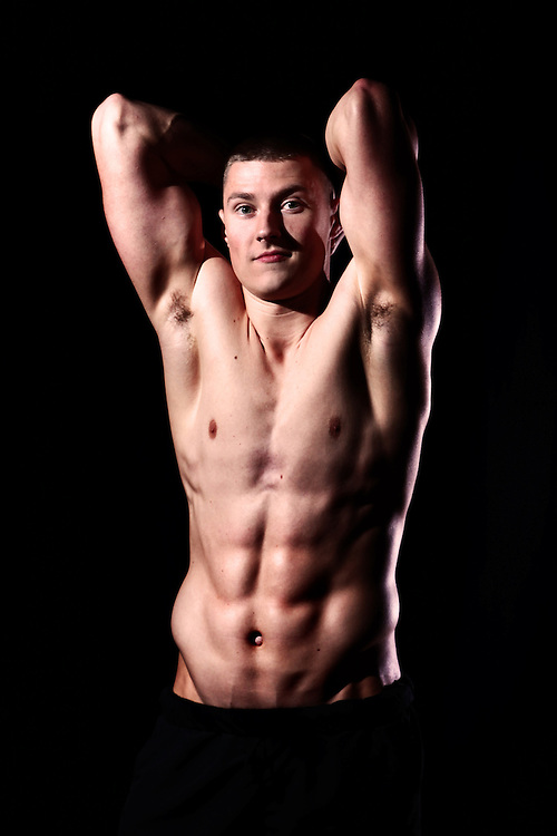 Fitness model for ON Optimum Nutrition, Jack (Jakk) Lowry with a traditional muscle pose.