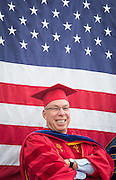 Dr. Greg Salsbury smiles from the stage during Commencement 2015 at Western State Colorado University.