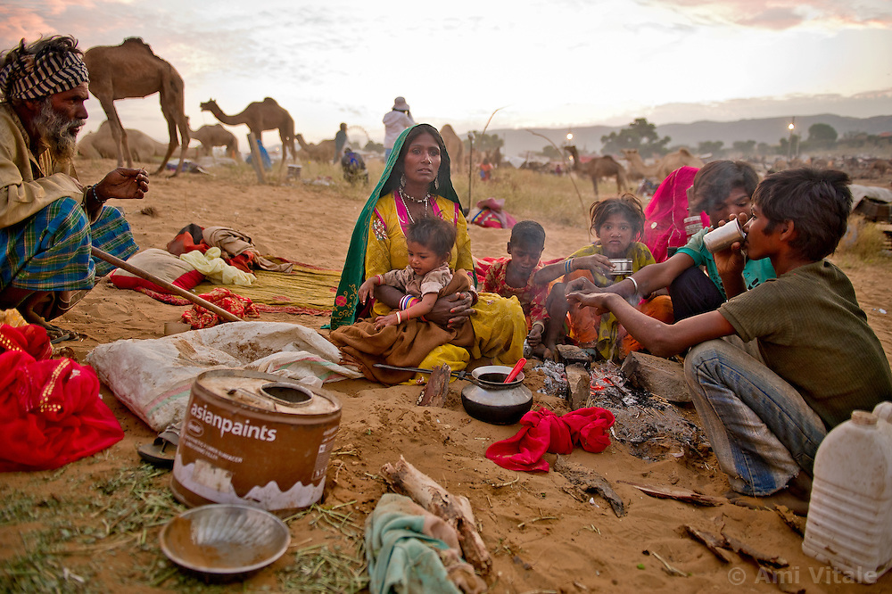 Anita Devi, 13 wakes up and prepares tea at the world's largest annual cattle fair in the desert town of Pushkar, in the Indian state of Rajasthan. Every year thousands of camel herders from the semi-nomadic Rabari tribe, who make a living rearing animals, travel for two to three weeks across 500 kilometers to set up camp in the desert dunes near Pushkar to sell their livestock. The herders sell more than 20,000 camels, horses and other animals at the annual cattle fair.