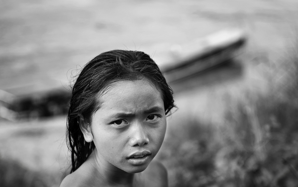 A girl after bathing in the Mekong river, Laos.