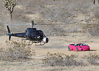 "March 15th, 2010 Lancaster CA. **EXCLUSIVE PHOTO** Rapper Nikki Manaj films a music video for her first single ""Massive Attack"". The video is directed by Hype Williams and features Rapper Birdman as well as Kanye West's girlfriend Amber Rose. Real Life BFF's Nikki and Amber sped around the desert in a pink Lamborghini while being chased and filmed by a helicopter. Photo by Eric Ford/ On Location News 818-613-3955  info@onlocationnews.com"