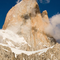 Mount Fitz Roy is visited by throngs of would be conquerers annually, but the relentless Patagonian winds can bring roiling clouds and foul weather in the blink of an eye and send many climbers packing without reaching the summit.  The Andean peak is located in a disputed border region between Chile and Argentina.